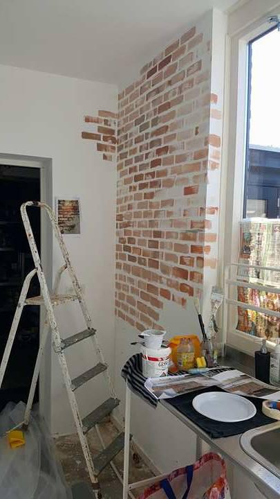 muurschildering stenen muur industriële look Janet Edens keuken