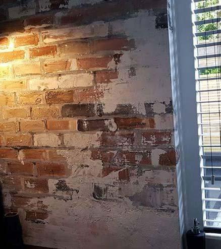 detail muurschildering stenen muur Janet Edens